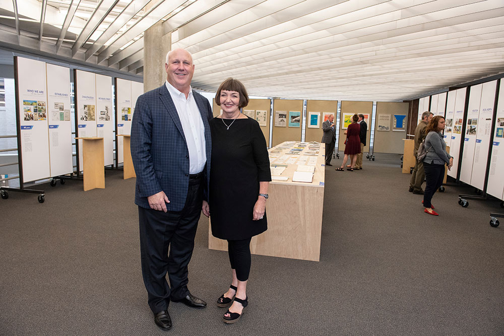 "Richard and Charlotte McNeel stand in the newly named  ""Charlotte and Richard McNeel Architecture Gallery"""