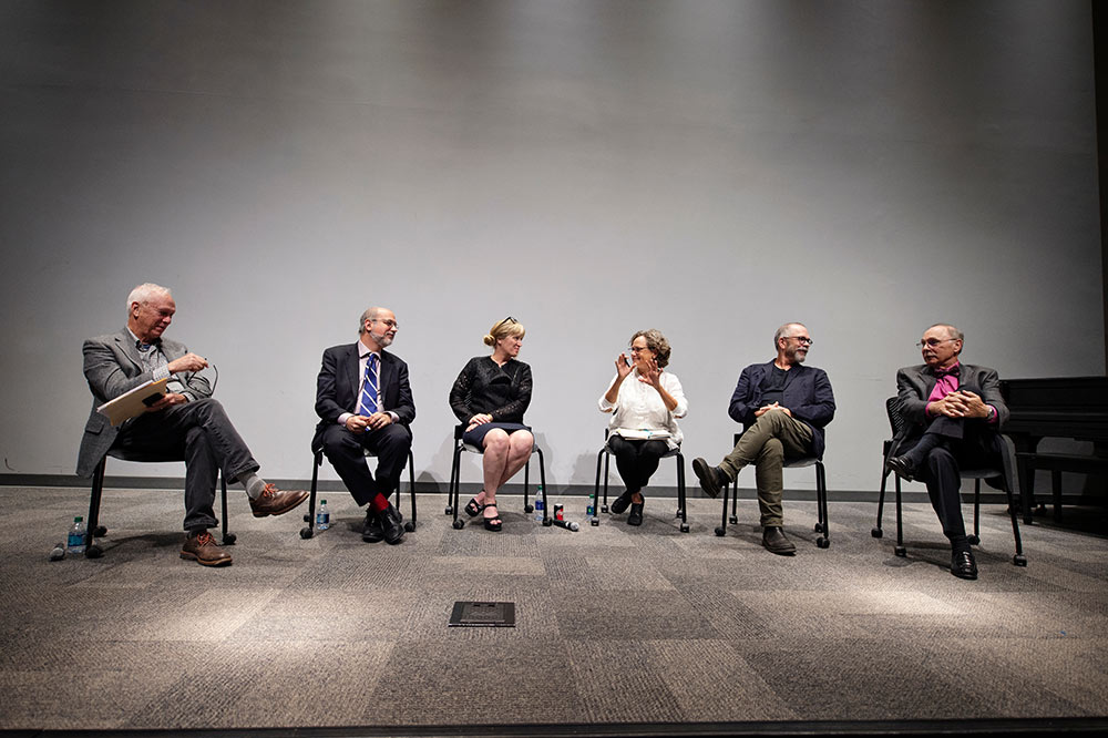 Panelists (seated, l-r) include John McRae, John Poros, Kimberly Brown, Shannon Criss, Nils Gore, and Michael Buono.